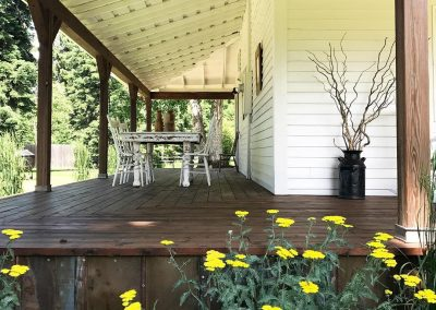 After: wrap around porch-new decking