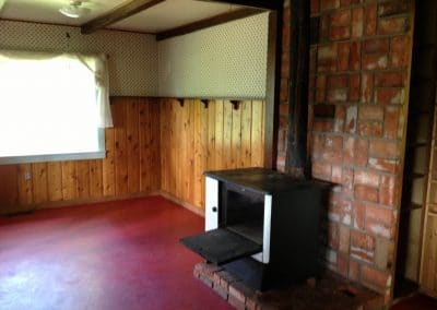 Before: dining room w/ original wood stove